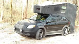 roof rack on the bed cover-images.jpeg